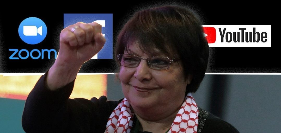 Photo of Leila Khaled wearing a keffiyeh with fist raised in the air, logos of Zoom, Facebook, and YouTube in the background.